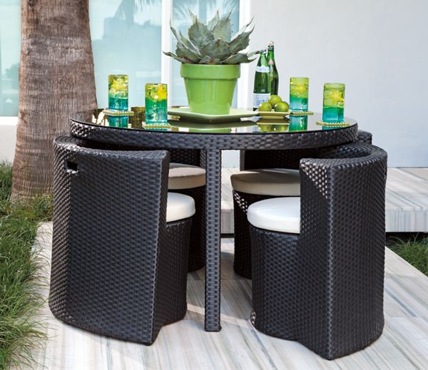 Just because you have a small deck, doesn't mean you can't entertain. This table tucks a whole dining set inside it.