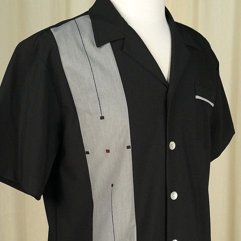 Sleeper Atomic Bowling Shirt:This is a sleek black bowling shirt with a dark gray panel down the front with black vetical lines and black and maroon embroidered squares. It has pearlized shell buttons and a gray piped pocket on the opposite side with a matching embroidered maroon square. The back has a tiny black on black fluer de lis embroidered on the collar.... $42.00