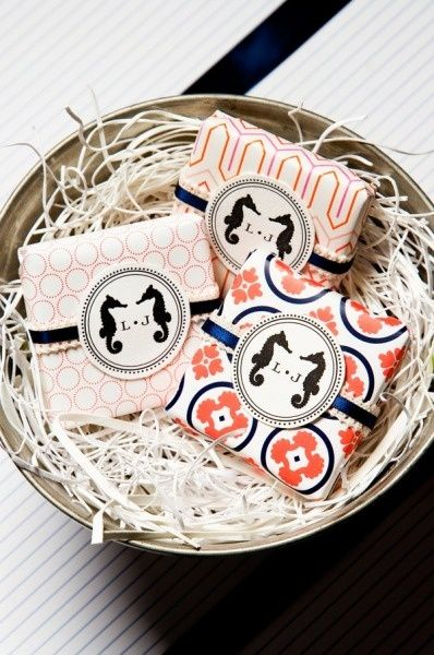 soap favors - these would be easy and great for everyone.  Get patterned paper like in the picture and just print stickers with a baseball and thank you across them.  We could display them in baseball mitts near the door for people to take on the way out