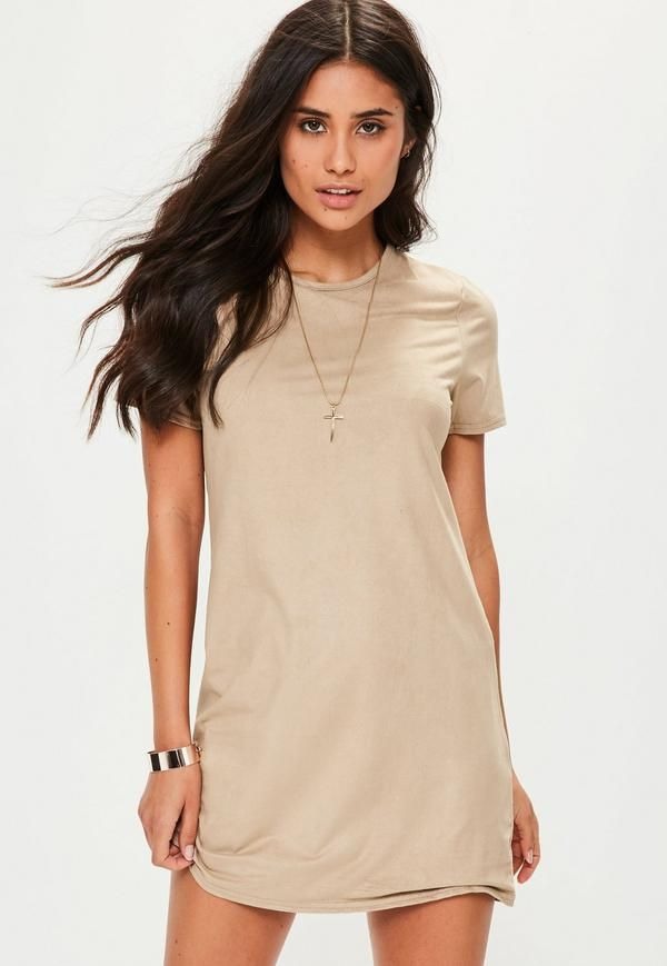 This t-shirt dress features a mini length, faux suede fabric in a beige hue with a round neck and stretch fit.