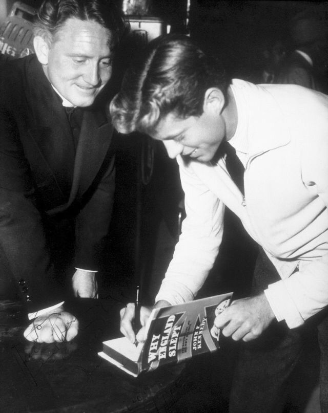 1940s, JFK signs his book, Why England slept, for actor Spencer Tracy