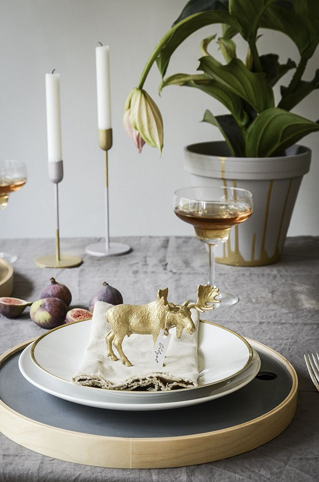 Upcycle childrens left over toys into great decorations for the table setting.