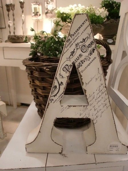 Mod podge a copy of your marriage certificate to your last name initial!!!!