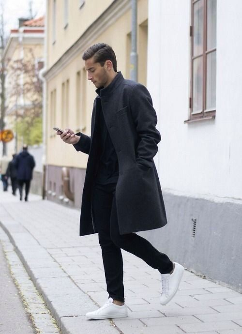 Overcoats are cut to enhance the effect of your suit and up your style game. Image via infashionity Tailored overcoats are making a comeback in men's fashion.