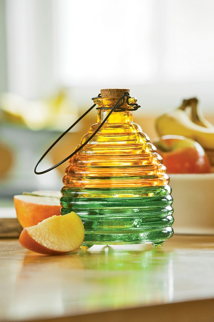 Fruit fly trap: Use an old, pretty narrow neck glass jar (like one of the pretty syrup jars sitting around that you can't toss), fill with vinegar and a squirt of dishwashing soap.  No cover or funnel necessary, and it looks pretty enough to leave on the counter.  KLHPest Repel, Jars Sitting, Dishwashers Soaps, Fly Trap, Narrow Neck, Fruit Fly, Neck Glasses, Glasses Jars, Pretty
