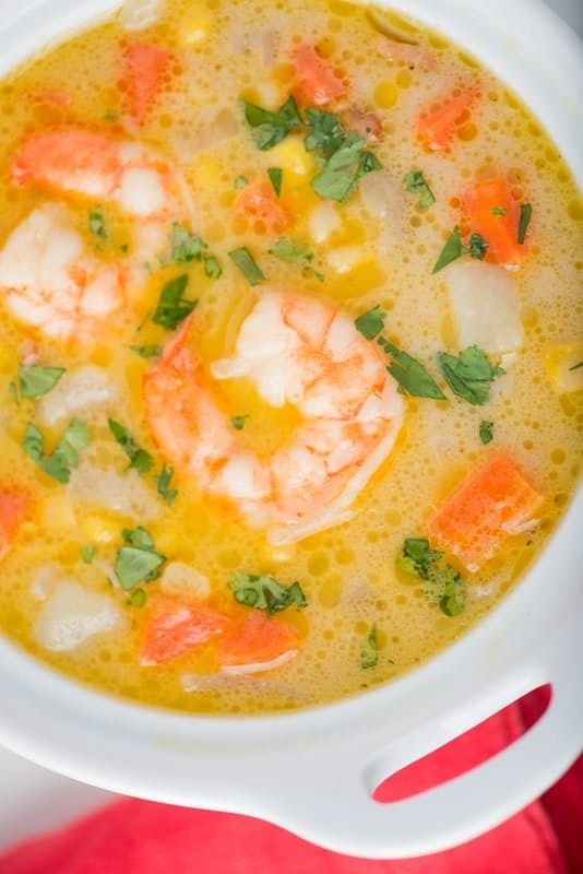 Easy Weeknight Shrimp and Corn Chowder Soup Recipe. This is a delicious and healthy way to eat shrimp for dinner and eat more veggies too. Simple recipe made with bacon, onion, butter, chicken broth, potatoes, carrots, frozen or fresh corn, milk, and frozen shrimp. Fast and quick comfort food that everyone will love!