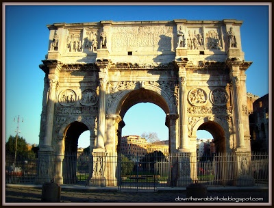 """Stand under the Arch of Constantine in Rome, Italy. Find out more at """"Down the Wrabbit Hole - The Travel Bucket List"""". Click the image for the blog post."""