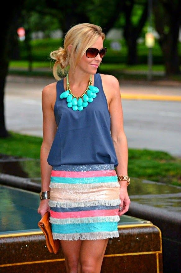 Royal blue sleeveless blouse with colorful stripes cute skirt and brown leather clutch and magic mint necklace and watch