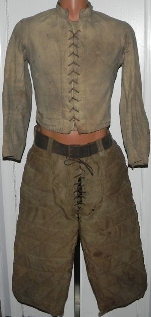 Extremely Scarce 19th Century Lace Up Smock Jacket with matching Moleskin Quilted Football Pants with their original belt.  These Smock Football uniforms are very rare, but this long sleeve Smock Jacket is the first of its kind I have ever encountered or seen.  Adding to its great look, the back of the forearm areas of both sleeves have built in quilted padding.  Stunning football uniform dating to the late 1880's or early 1890's.