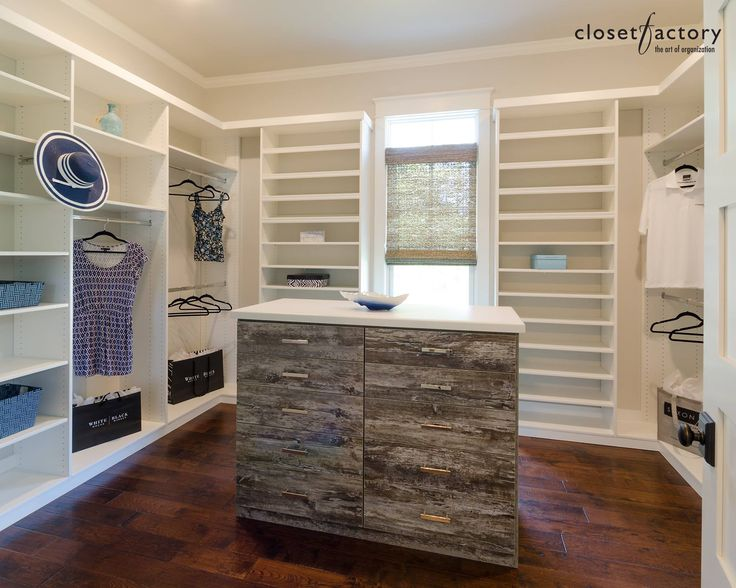 A gorgeous walk in with an accented center island for Southern closets