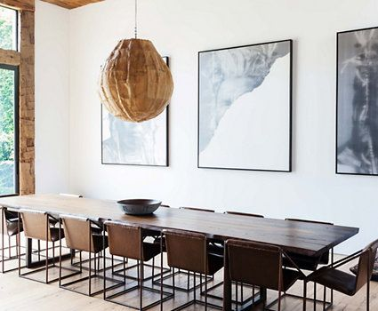 Jenni Kayne's dining room. Leather and iron dining chairs. Large, black and white, abstract art.