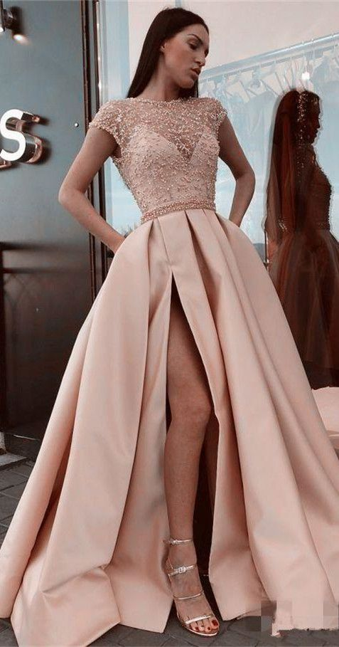This shimmering evening dress features a transpare…