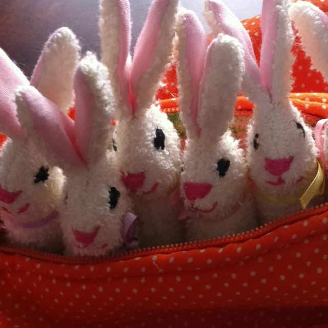 Closeup picture of Easter bunny rabbits I made from washcloths. Embroidered faces. So cute for Easter this year.