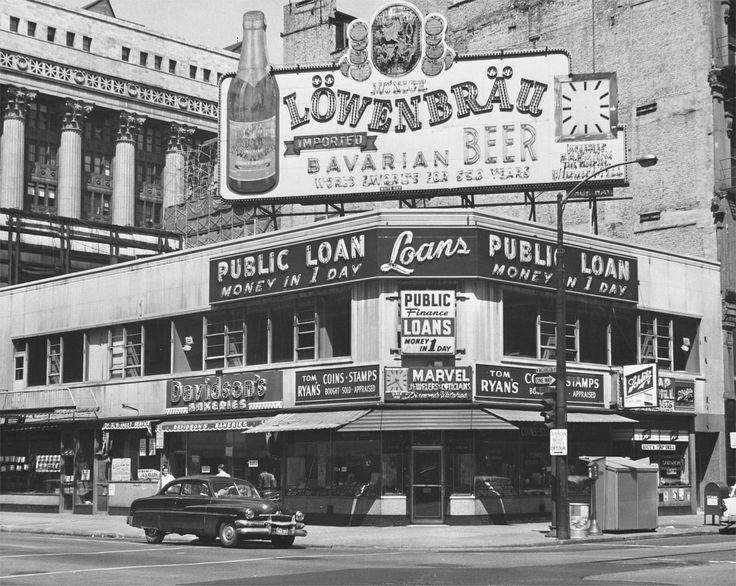 Corner of Washington & Dearborn streets in Chicago, 1962. The block bordered by this corner and Clark & Randolph streets --   including everything seen here --  would soon be demolished to make way for Daley Plaza and the 648-foot tall, 31-story Richard J. Daley Center, which opened in 1965 as the city's tallest building. The mark would stand until completion of the John Hancock Center in 1969.