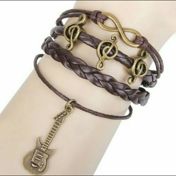 LEATHER CHARM BRACELET - PP25 OR GUITAR The latest fad leather bracelets. BUY AND SAVE!!  Happy shopping!  $8.00 SALE!!!!!!       PP25 Jewelry Bracelets