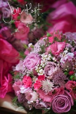 Pretty bridal bouquet. Pinks and purples. Purple Roses.