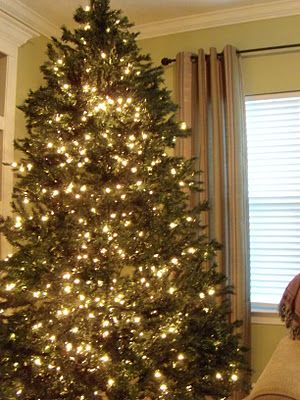 How to make your artificial tree look fuller and brighter! I am so excited about this idea. I happen to have pre-lit garland that has never been opened, BONUS!