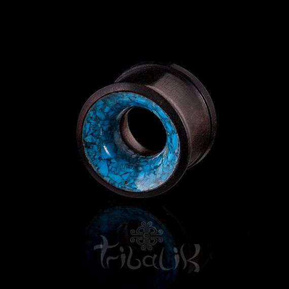 An interesting tunnel for stretched ears made from black wood and turquoise powder.   They come in sizes from 6mm / 2g up to 16mm / approx. 5/8 inch.