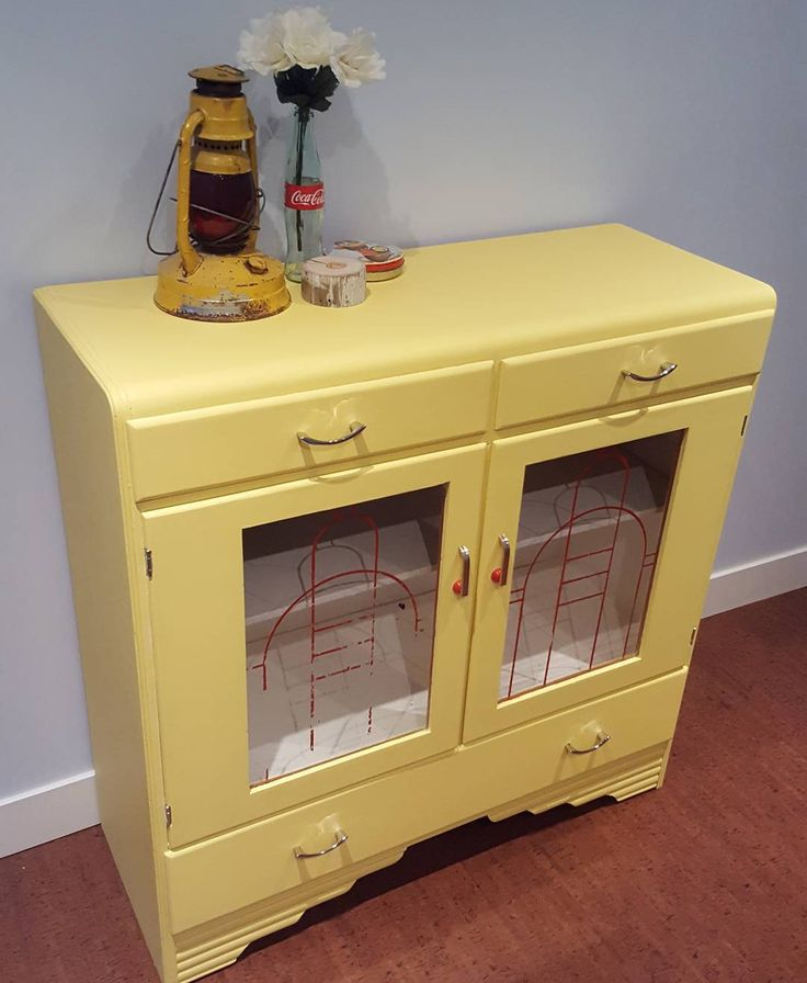 How about a little ray of sunshine for these winter days?  Brought some new life into this vintage cabinet with a bright pop of paint!  The retro red detailing on those glass doors though!  #HistorymeetHandmade