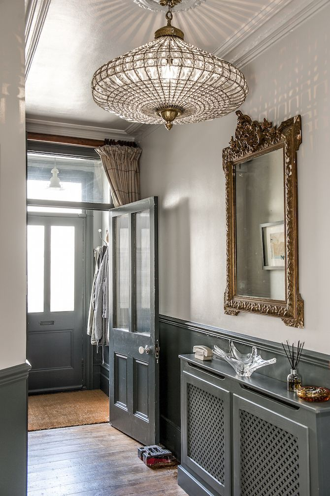 The grand chandelier in the entrance catches the light beautifully. #WTinteriors #interiors #hallwayideas