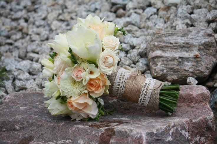 wedding bouquet with amarylis, roses, dahlia and freesia