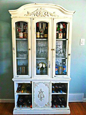 Old China cabinet turned into a bar. Adorable.
