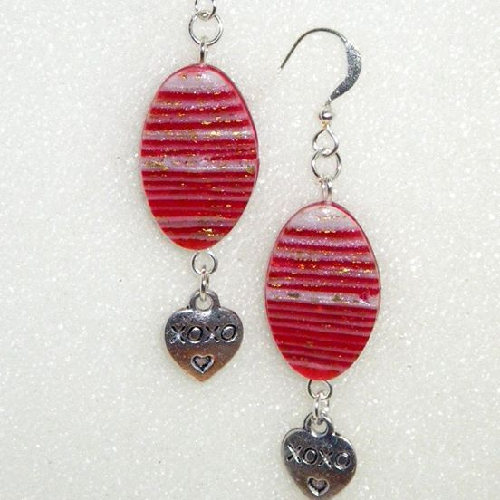 Clean modern look, polymer clay earrings. These earrings are fully handcrafted from polymer clay. Bright and joyful! Ruby-red and shimmering white clay, decorated with gold leaf suitable for everyday wear. They are light-weight and have been sanded and buffed to smooth and more shine! Assembled with matching silver steel hardware in heart shape. About 5 cm in length