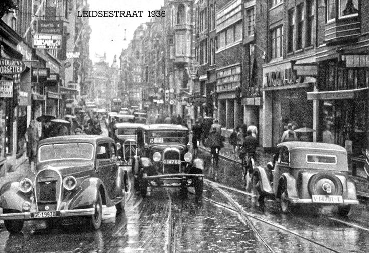 1936 - 1940. A view of the Leidsestraat in Amsterdam. The Leidsestraat, a busy shopping street in Amsterdam, located between the Koningsplein and the Leidseplein. The street, which crosses the Herengracht, Keizersgracht and Prinsengracht, dates back to great city expansion of 1658 ran from the Heiligewegspoort to the Leidsepoort in the direction of the city of Leiden. Since 1971 is the street a pedestrian area closed for all traffic and bicyclists. Photo Serc. #amsterdam #1940 #Leidsestraat