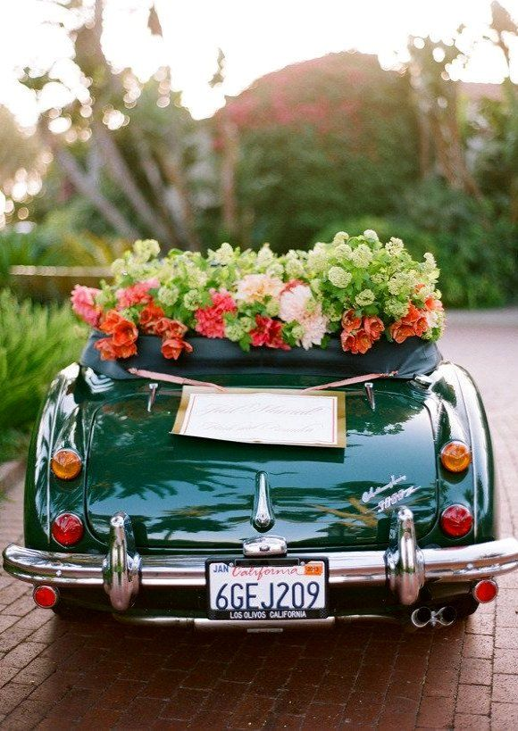 25 creative wedding getaway cars decorated with tons of green pink and orange flowers and a sweet handmade just married sign this vintage green car