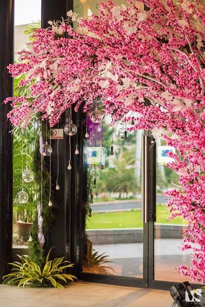 Wedding and Sangeet Decor - Pink and Peach Entrance Floral Decor with Hanging Bulbs   WedMeGood #wedmegood #indianwedding #decor #DIY #pink #floral #hanging #bulbs