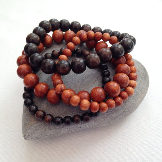 Simple and beautiful, natural, wooden beaded bracelets.  The beads come in two sizes, 6mm and 10mm. There are two different kinds of wood, the dark brown