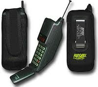 "Motorola Microtac 550 -- my first cell phone (1994.) It had a ""slim"" battery with a limited charge time and a heavier battery for longer life. They each slid onto the main body and needed to go on a charger at night. (pic is from an ad for the case shown -- not part of the phone, obviously.)"