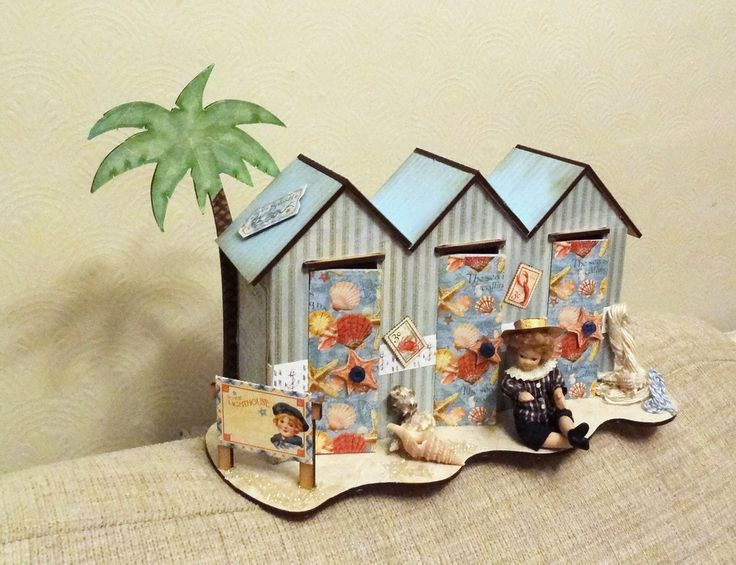 Beach huts from candy box crafts put together and covered with Graphic 45 papers