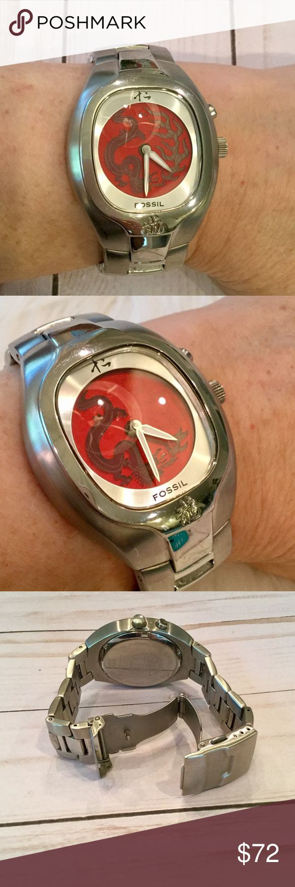 """Fossil Big Tic Animated Dragon Face Watch, EUC ⭐️Authentic Fossil Big Tic Wristwatch ⭐️Stainless steel band ⭐️Red Dragon face that's animated; it disappears then reappears. See first two photos. ⭐️New Battery and running perfectly ⭐️The inside measures 7.5"""" around ⭐️Condition: Crystal looks excellent with no scratches. Some minor scuffs on stainless steel around the crystal from normal wear. In excellent preowned condition.                             (Sandy) Fossil Accessories Watches"""