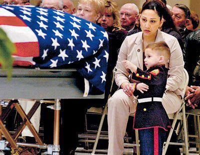 Two-year-old Tyler Miles wearing Marine dress blues and points at the flag-covered casket of his father, Marine Sergeant Sean H. Miles, who was kil… | Troops ,…