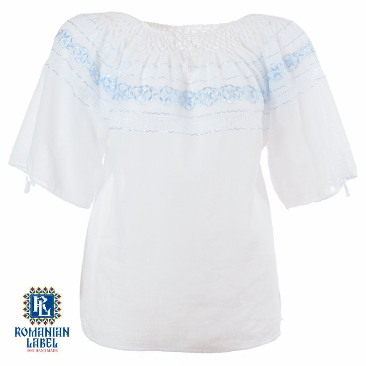 $84.20 A 100% hand made traditional blouse, exclusively tailored out of natural materials, such as ivory cotton and blue silk embroidery.