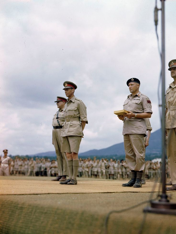 """Britain's King George VI with the commander of the 1st Canadian Corps, General-Lieutenant Edson """"Tommy"""" Burns, on the right (partly in the frame) and the commander of the 5th Canadian Armoured Division, Major-General Bert Hoffmeister in Italy on the day of awards to soldiers and officers, who distinguished themselves in combat. July 31, 1944."""