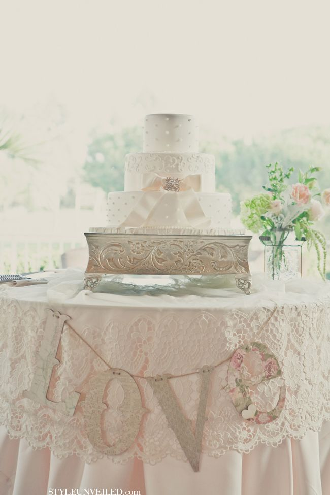 Cake table dressed in lace and love banner with a silver for Beautiful cake stands