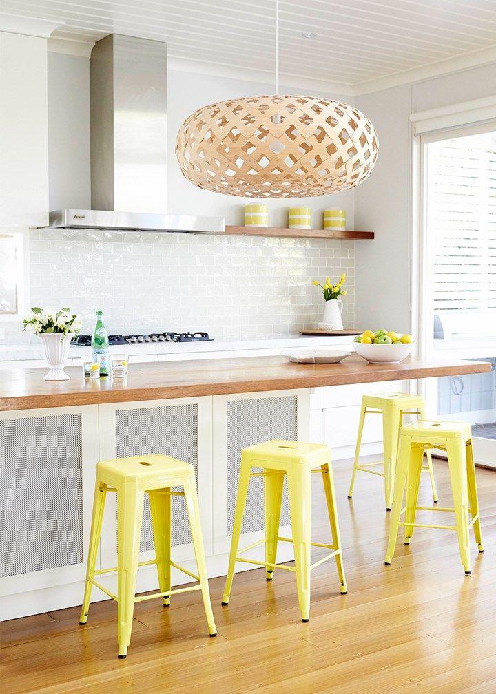 Coastal home kitchen with a pop of yellow | Home Beautiful Magazine Australia
