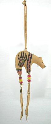 Oglala Lakota bear hand painted on leather and stuffed with buffalo fur.