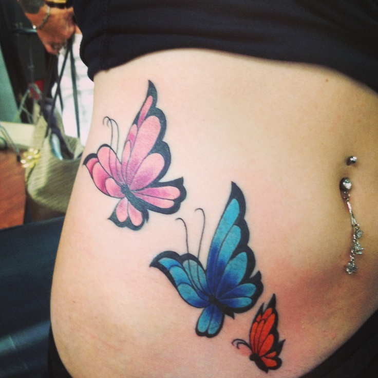 Butterfly tattoo on side of stomach...I plan on adding ...