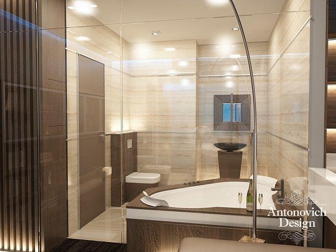 ЖК Город Яхт. Ванную комнату и спальню разделяет прозрачная перегородка из стекла. Все стены и пол ванной выложены мозаичной плиткой теплого коричневого оттенка.