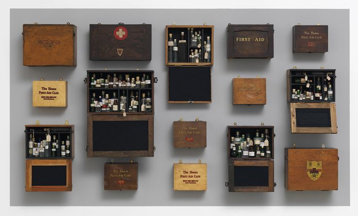 """Susan Hiller 2011 """"Homage to Joseph Beuys series"""" Wall installation of vintage, felt-lined medicine cabinets, filled with antique glass bottles, containing holy water from springs and wells around the world. Utilize glass vessels, felt, and water, alludes to the ways in which Beuys made symbolic use of matter-of-fact materials, sacramentalizing everyday activities and storing up energy in prosaic objects or experiences."""