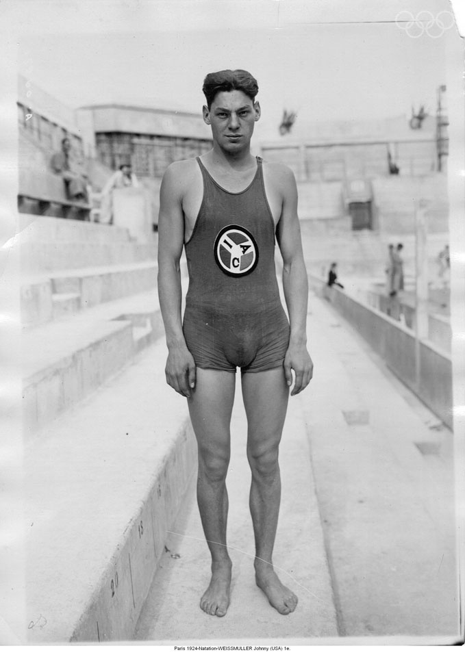 Johnny WEISSMULLER | Olympic Athlete | Amsterdam 1928, Paris 1924 -  US competition swimmer and actor best known for playing Tarzan in films of the 1930s and 1940s and for having one of the best competitive swimming records of the 20th century and world's fastest swimmers in the 1920s; 5 Olympic gold medals for swimming and 1 bronze medal for water polo. 52 US National Championships, set 67 world records and undefeated in official competition for the entirety of his competitive career.