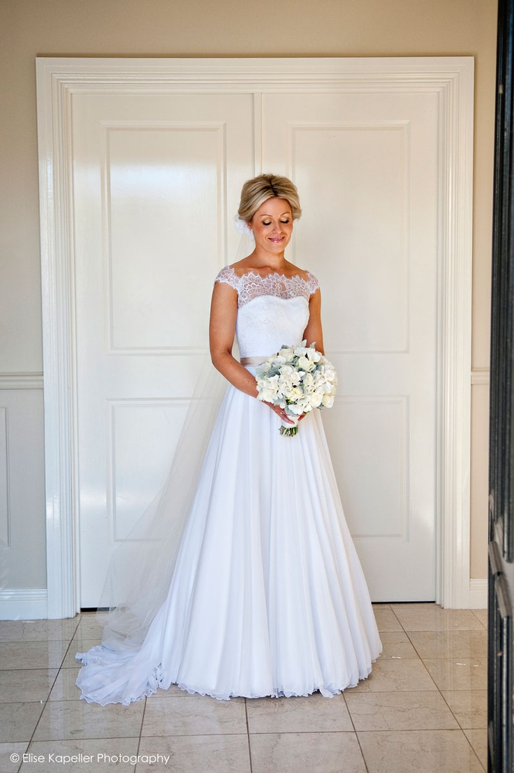 Off the shoulder lace sleeved ball gown. Catherine R Couture.