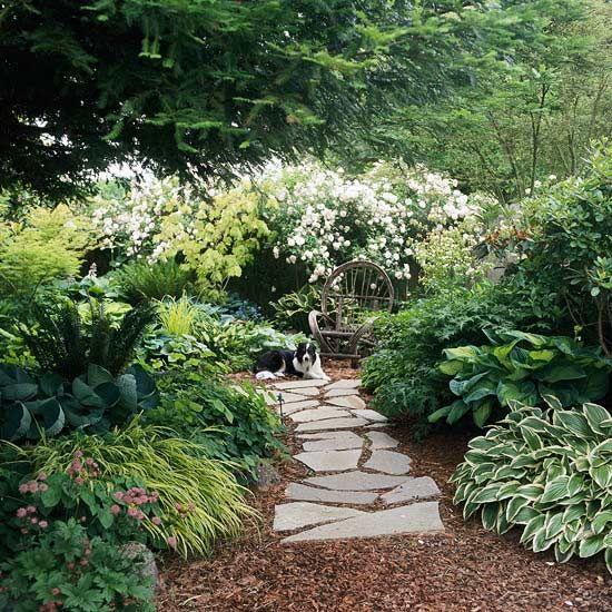 Flagstone Walkway Design Ideas irregular flagstone path through grass and garden flowers Garden Path Ideas Flagstone Walkways