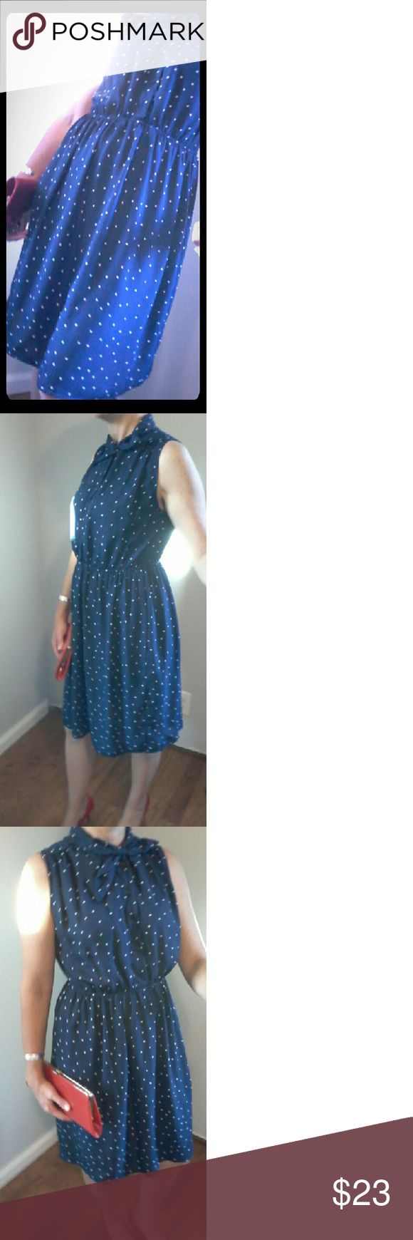 Holly Bracken navy blue polka dot dress Sleeve less and knee length. Under slip skirt hits at about mid thigh. Adorable classic neckline with a 1940's feel. Classic navy blue with white polka dots. Can be paired with cardigan for cooler weather. Was purchased in Atlanta Georgia's famous apparel mart. Worn about 5 times. Excellent condition. Size not mark but approximately a 6 with room to spare for a bigger bust and has a stretch waist. Smoke free home. Offers considered. Holly Bracken…