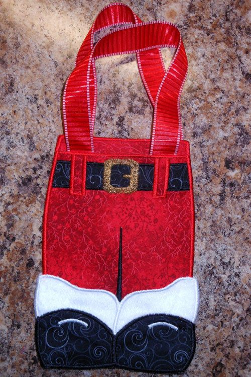 """Cute Santa Pants Gift Bag is so fun to make. Made 100% in the hoop with no additional sewing.  Easy to make and comes with instructions with pictures.   Design fits 5""""x7"""" and larger hoops  Actual Bag sizes: """".............4.90""""x 6.90""""....5.48""""x 7.70""""  This is a machine embroidery design. You will require an embroidery machine to stitch these designs. You also need a method to transfer the design file to your machine. This purchase is for the electronic design file only.   Standard Formats…"""