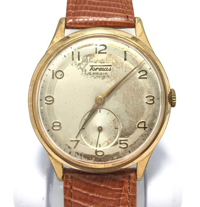 Tormas Regia Swiss - mannen horloge - 38mm - 1960  Tormas Regia Zwitserse Men's watch-ca. 1960-mechanische - handleiding-(Anton Schild) als beweging-17 Rubis-diam: 38mm-Vergulde geval-dol op acier inoxydable-lederen band lengte: 19cm (met gesp)-in zeer goede conditieOpmerking: een deel van de rug afdekkader ingebouwd ontbreekt (ca. 20mm) heeft geen invloed op sluiten. (zie laatste 4 foto's)Verzending: Per Mail / Post met tracking. Zal worden goed ingepakt en verzonden in een kartonnen doos…