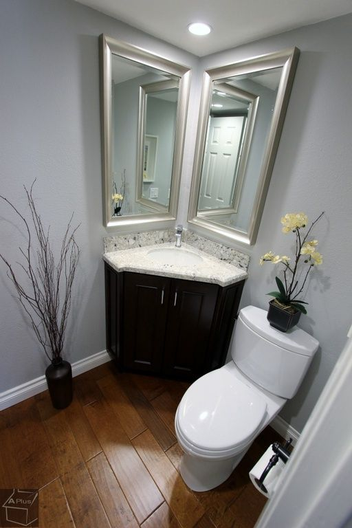 Perfect for Powder Room:  Traditional Powder Room with Hardwood floors, Flush, Granite White Galaxy Countertop, Powder room, Flat panel cabinets